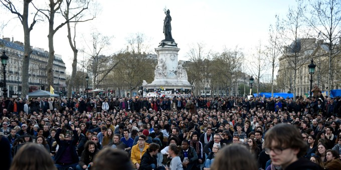 """French protesters gather at Place de La Republique in Paris as part of demonstrations by the Nuit Debout (Up All Night) movement on April 12, 2016. The Nuit Debout or """"Up All Night"""" protests began in opposition to the government's labour reforms seen as threatening workers' rights, but have since gathered a number of causes, from migrants' rights to anti-globalisation. AFP PHOTO / ERIC FEFERBERG / AFP PHOTO / ERIC FEFERBERG"""